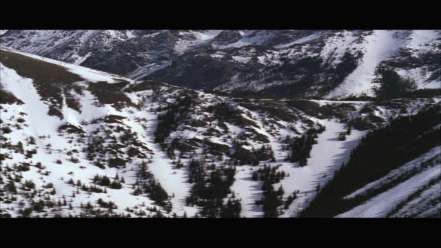 aerial ws pov view of snow covered mountains / unspecified - breitwandformat stock-videos und b-roll-filmmaterial