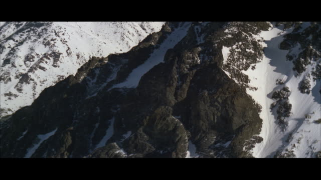 AERIAL WS POV View of snow covered mountains / Unspecified