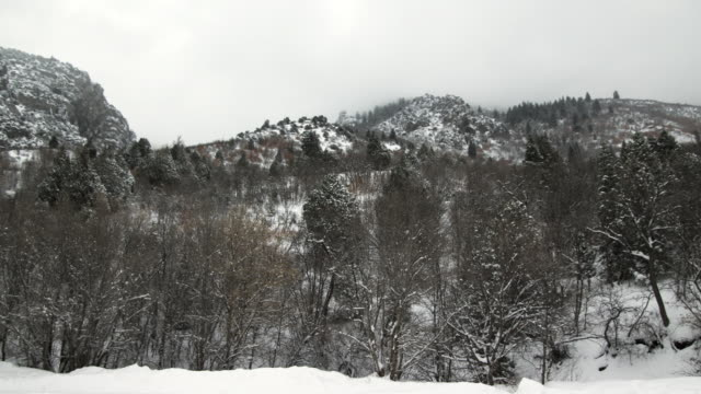 ws pan view of snow falling on mountains / payson, utah, usa - payson stock videos & royalty-free footage