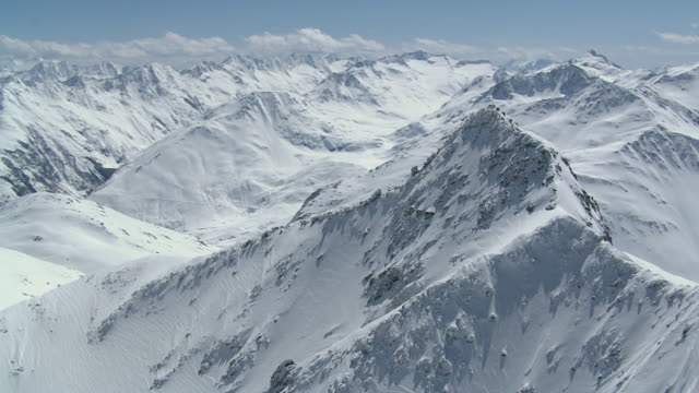 WS POV  View of snow mountains with valley / Oberalp, Uri, Switzerland
