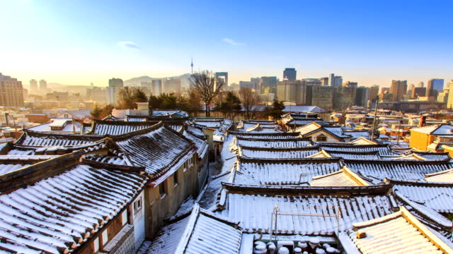 View of snow on Giwa (house made with Korean traditional roofing) at Bukchon Hanok Village (famous place for traditional Korean house and popular tourist destinations) in winter