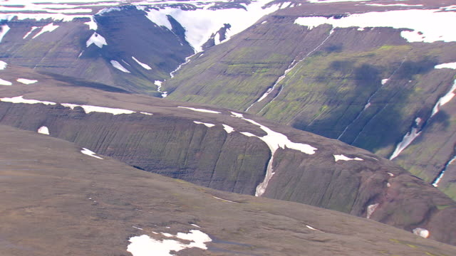 ms aerial view of snow on mountain with interlocking valley pattern / iceland - interlocked stock videos & royalty-free footage