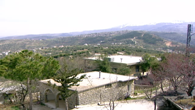 stockvideo's en b-roll-footage met view of snow-capped mount hermon, which straddles the border between syria and lebanon and has the highest permanently manned un position in the... - benen gespreid
