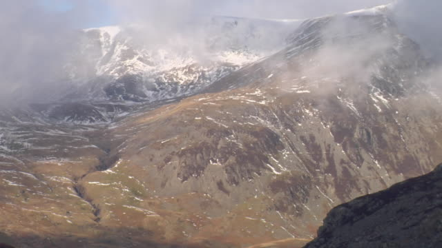 ws zo view of snowcapped mountains, lake and road / capel curig, snowdonia, uk - snowdonia stock videos & royalty-free footage
