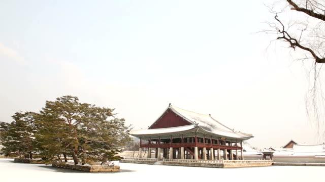 View of snow-covered Gyeonghoeru Pavilion (National Treasures of South Korea 224) in Gyeongbokgung Royal Palace (Korean National Treasure 223)