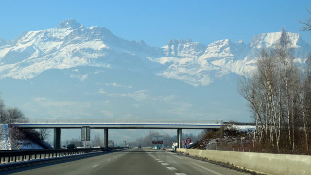 View of snow-covered mountains on the Highway in Chamonix