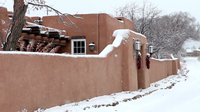 WS PAN View of snowing outside adobe house / Lamy, New Mexico, USA