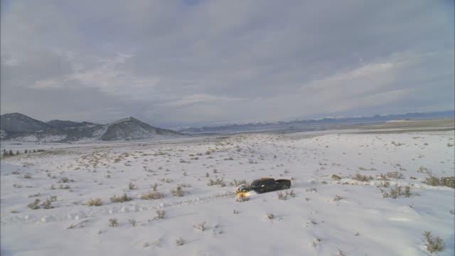 ws pov view of snowplow driving through mountain landscape / mammoth lakes, california, usa - mammoth lakes video stock e b–roll