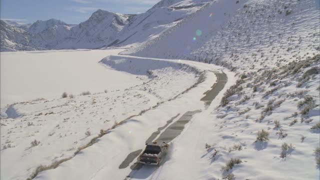 ws pov tu view of snowplow driving through mountain road / mammoth lakes, california, usa - mammoth lakes video stock e b–roll