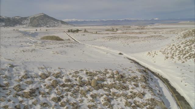 ws pov view of snowplow driving through mountain road / mammoth lakes, california, usa - mammoth lakes video stock e b–roll
