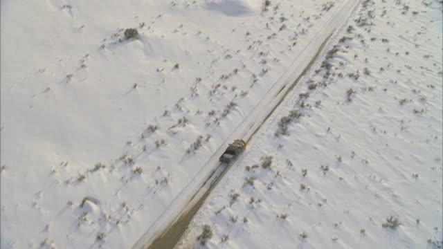 ws pov view of snowplow on snowy road / mammoth lakes, california, usa - mammoth lakes video stock e b–roll