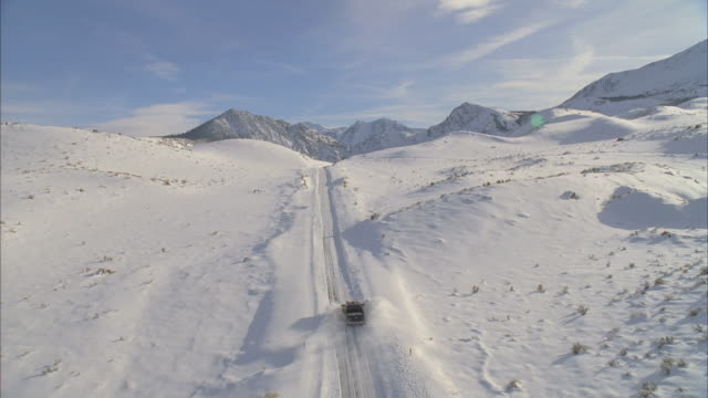 ws pov view of snowplow plowing through mountain road / mammoth lakes, california, usa - mammoth lakes video stock e b–roll