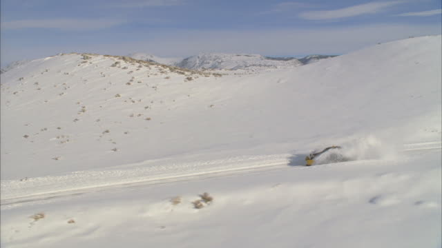 ws pov view of snowplow plowing through mountains / mammoth lakes, california, usa - mammoth lakes video stock e b–roll