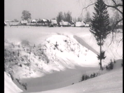 WS View of snowy landscape quiet life in village during winter / Russia AUDIO