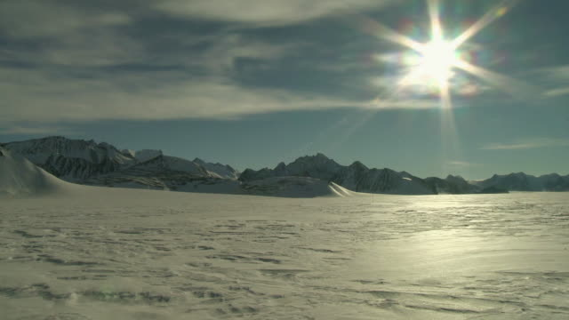 EWS View of Snowy landscape with mountains and bright sunshine / Union Glacier, Heritage Range, Ellsworth Mountains, Antarctica