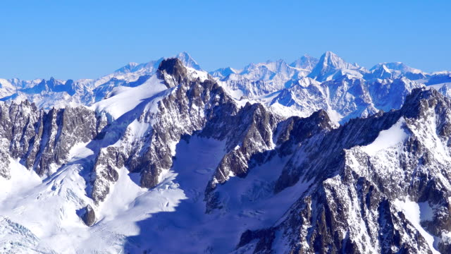view of snowy mountains at mont blanc (highest mountain in alps) - mont blanc stock videos & royalty-free footage