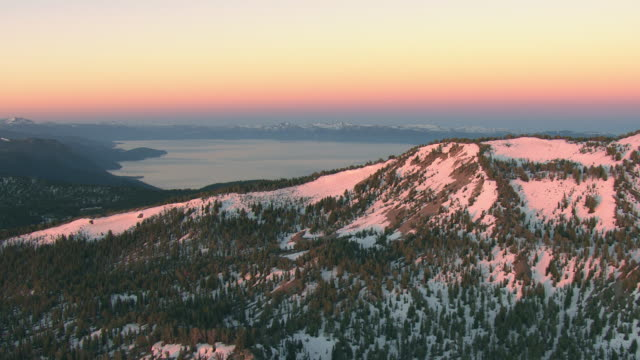 WS AERIAL View of snowy peaks at Mount Rose with morning light in Sierra Nevada / Nevada, United States