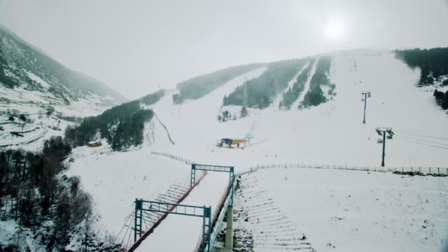 ws pan t/l view of snowy ski resort / andorra, spain  - ski lift stock videos & royalty-free footage