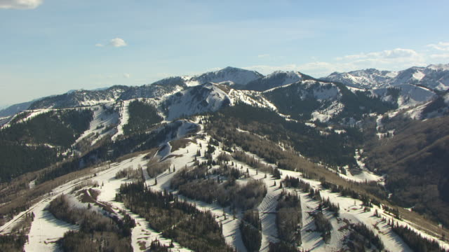 ms aerial view of snowy ski slopes / park city, utah, united states - park city utah video stock e b–roll