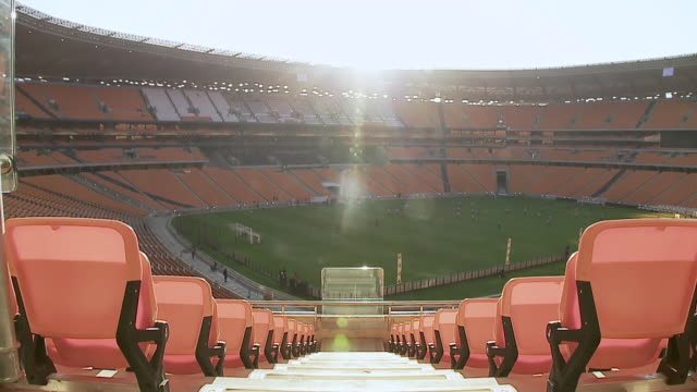 WS View of Soccer players training on field inside Soccer City / Johannesburg, Gauteng, South Africa