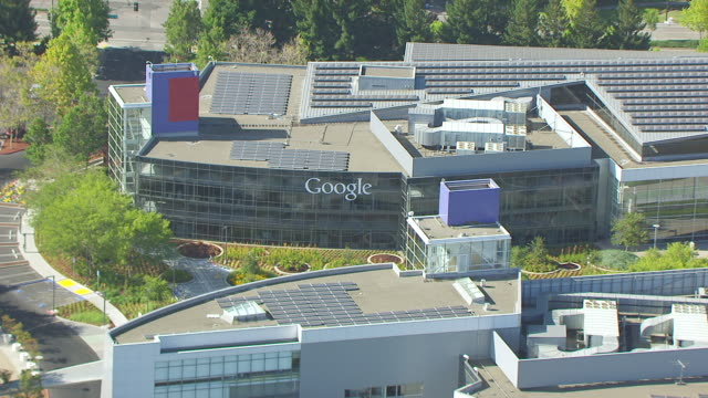 WS PAN AERIAL POV View of solar panels on roof of building, Googleplex, Google campus area / Mountain View, California, United States