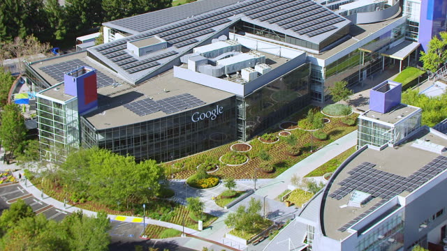 MS ZO AERIAL POV View of solar panels on roof of building, Googleplex, Google campus area / Mountain View, California, United States
