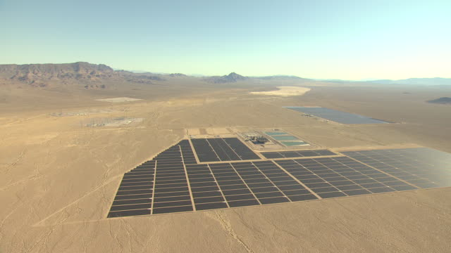 WS AERIAL View of solar photovoltaic power plant at Copper Mountain Solar Plant surrounded by desert and mountains / Boulder City, Nevada, United States