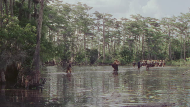 WS View of soldier going through river