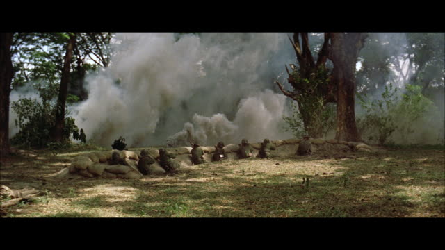 ws view of soldiers in jungle trench and heavy explosions - trench stock videos and b-roll footage