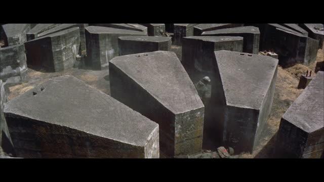 ms tu view of soldiers searching through railroad head - pietra materiale da costruzione video stock e b–roll