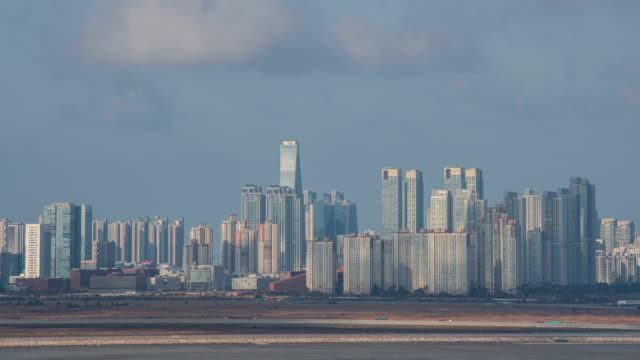 view of songdo international business district, shot from baegot life park in the western sea / siheung-si, gyeonggi-do, south korea - sea life park stock videos & royalty-free footage
