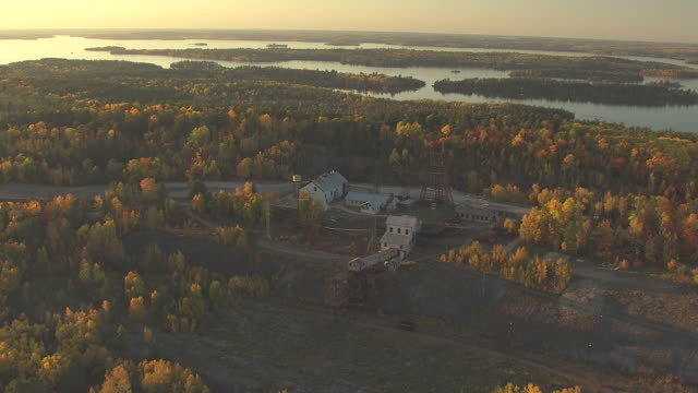 ws aerial view of soudan underground mine surrounding by fall trees / minnesota, united states - minnesota stock videos & royalty-free footage