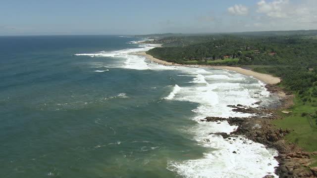vídeos y material grabado en eventos de stock de ws aerial view of south coast in durban / durban, kwazulu natal, south africa - kwazulu natal