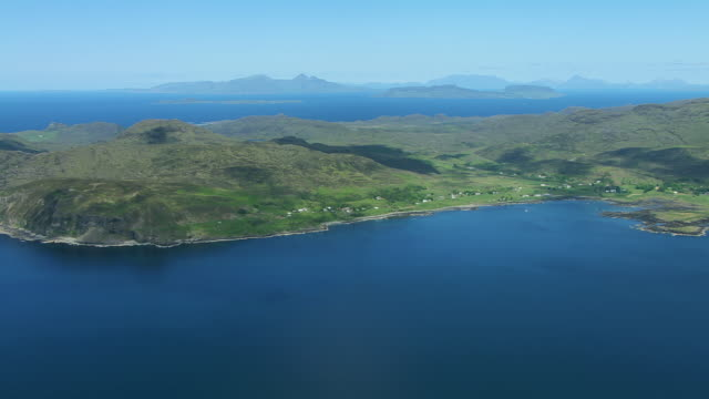 ws aerial view of south coast of ardnamurchan peninsular on west coast with isle of rum and isle of eigg / morvern, inverness shire, scotland - inverness scotland stock videos & royalty-free footage