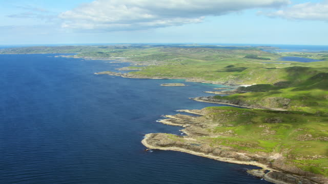 WS AERIAL View of south coast with idyllic beach and remote farm houses and village by sea / Isle or island of Mull, Argyll and Bute, Scotland