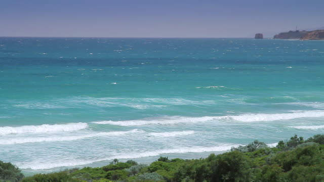 ws pan view of southern ocean in front of aireys inlet lighthouse / aireys inlet, victoria, australia - antarctic ocean stock videos & royalty-free footage