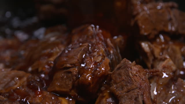 view of soy sauce being poured on ppyeo jjim(braised back ribs in south korea) - braised stock videos and b-roll footage