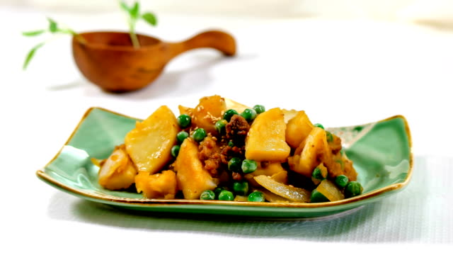 View of soy sauce braised potatoes on a plate (Korean traditional side dish)