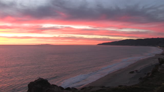 ws view of spectacular sunset over zuma beach / malibu, california, united states - malibu stock videos & royalty-free footage