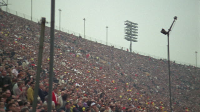 ws pan view of spectator at university of southern california stadium / los angeles, usa - anno 1968 video stock e b–roll