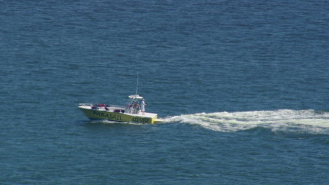 ws aerial zi zo view of speed boat in ocean / virginia, united states - speed boat stock videos & royalty-free footage