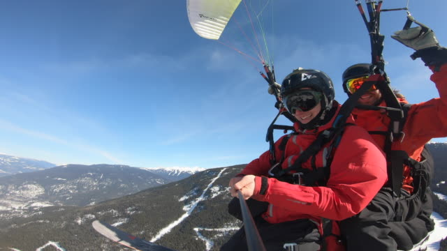 pov view of speed flying riding parachuting paragliding, snow skiing down a mountain. - winter sport stock videos & royalty-free footage