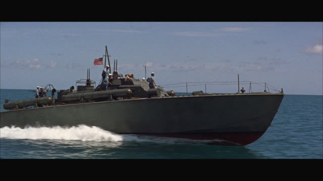stockvideo's en b-roll-footage met ws pan view of speeding p-t boat / usa - amerikaanse zeemacht
