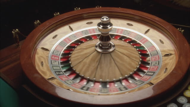 cu view of spinning roulette wheel - roulette stock videos and b-roll footage