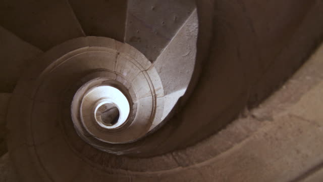 cu pan view of spiral staircase in covento st. cristo on top view / tomar, santarì©m, portugal - spiral staircase stock videos & royalty-free footage