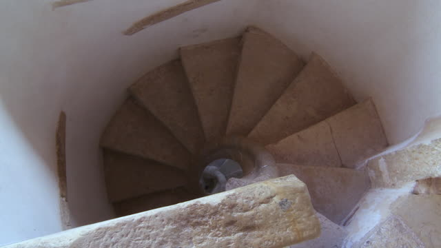 cu pan view of spiral staircase in covento st. cristo on top view/ tomar, santarì©m, portugal - spiral staircase stock videos & royalty-free footage