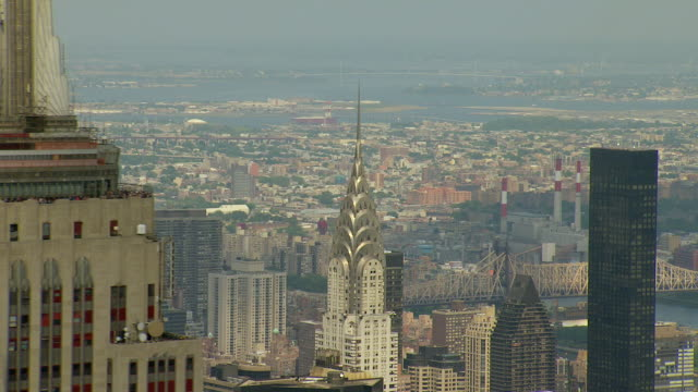 ws aerial view of spire of chrysler building and nearby surrounding tops of buildings / new york, united states - spire stock videos & royalty-free footage