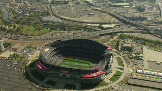 WS TU AERIAL View of sports authority field at mile high stadium with parking lot and downtown skyscrapers / Denver, Colorado, United States