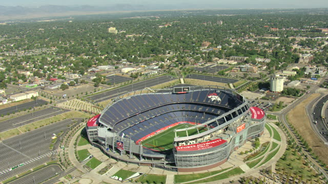 WS AERIAL View of sports authority field at mile high with broncos mascot on stadium seating / Denver, Colorado, United States