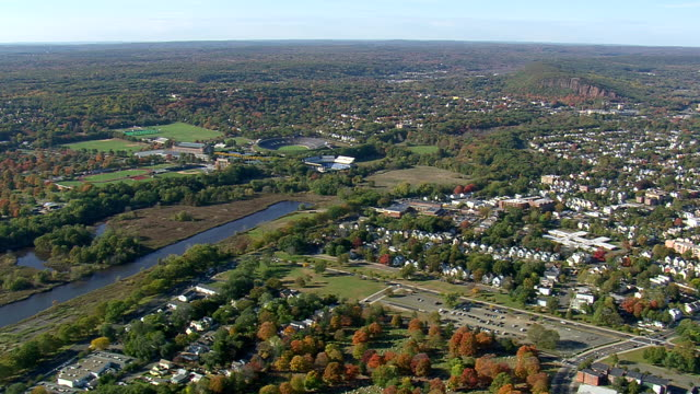 ws aerial zi view of sports stadium in new haven city / connecticut, united states - new haven stock-videos und b-roll-filmmaterial